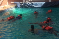 Learners learning how to swim before Yatch Club